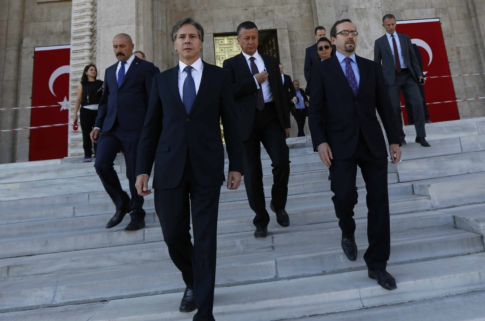 Then-U.S. Deputy Secretary of State Antony Blinken (Center L), accompanied by then-U.S. Ambassador to Ankara John Bass (R), leaves the Turkish Parliament after observing the damaged parts of the building due to the bombing of the Gülenist Terror Group (FETÖ) coup plotters on the night of the July 15 failed coup attempt, Ankara, Turkey, Sept. 27, 2016. (Photo by Ali Ekeyılmaz)