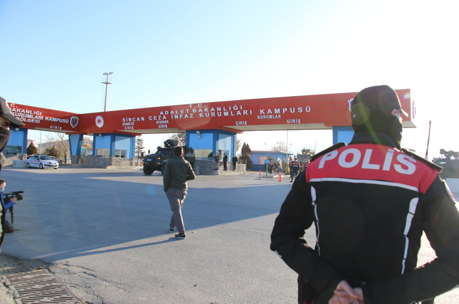 A police officer stands guard at the entrance of the courthouse-prison complex where the trial was held, in the capital Ankara, Turkey, Nov. 26, 2020. (IHA Photo)