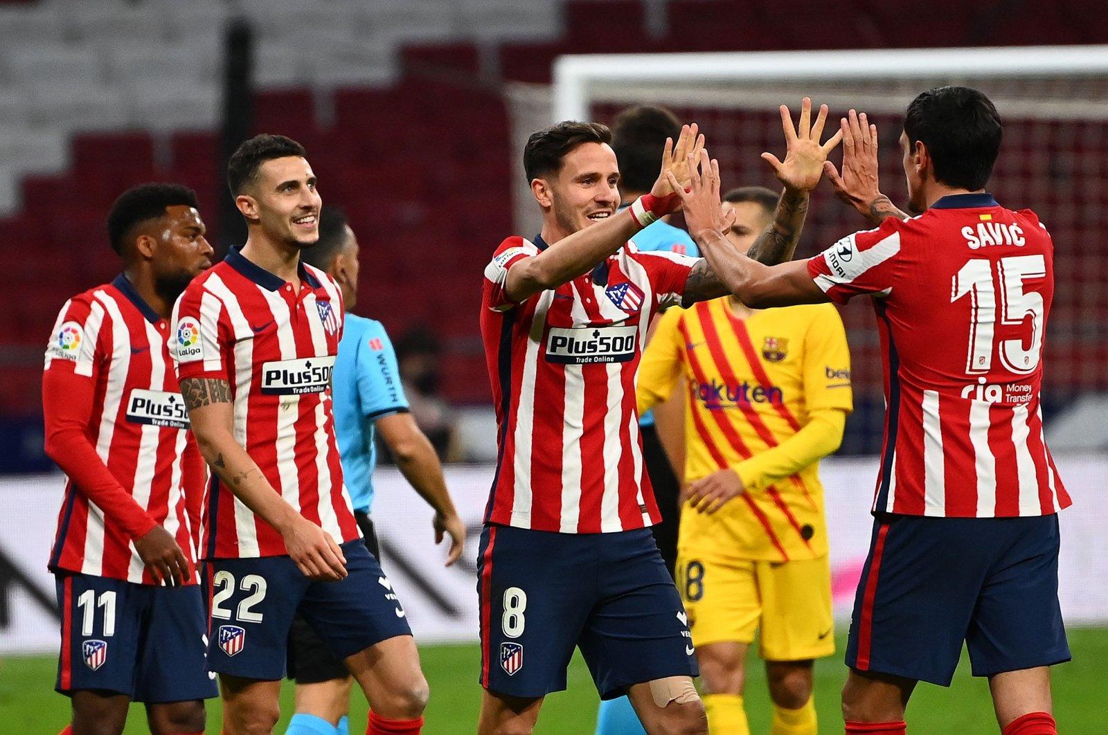 Atletico Madrid players celebrate winning a La Liga match against Barcelona, in Madrid, Spain, Nov. 21, 2020. (AFP Photo)