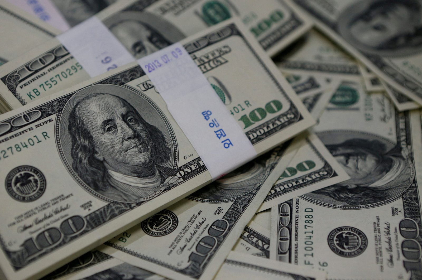 U.S. $100 bills are seen in this picture illustration, Aug. 2, 2013. (Reuters Photo)
