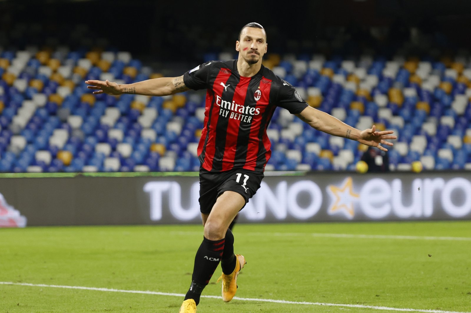 AC Milan's Zlatan Ibrahimovic celebrates after scoring his team's first goal against Napoli while wearing red face paint to raise awareness of domestic violence against women, Naples, Italy, Nov. 22, 2020. (Reuters Photo)