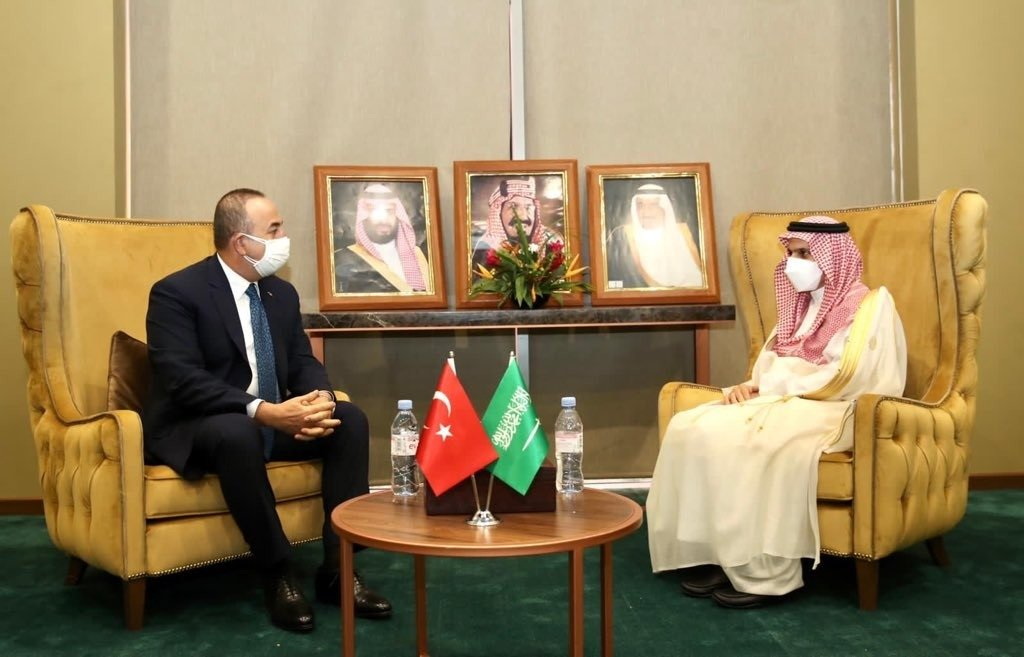 Foreign Minister Çavuşoğlu (L) and his Saudi counterpart Farhan bin Abdullah Al Saud meet on the sidelines of the Organization of Islamic Cooperation's (OIC) Council of Foreign Ministers in Niger's Niamey, Nov. 27, 2020 (IHA Photo)