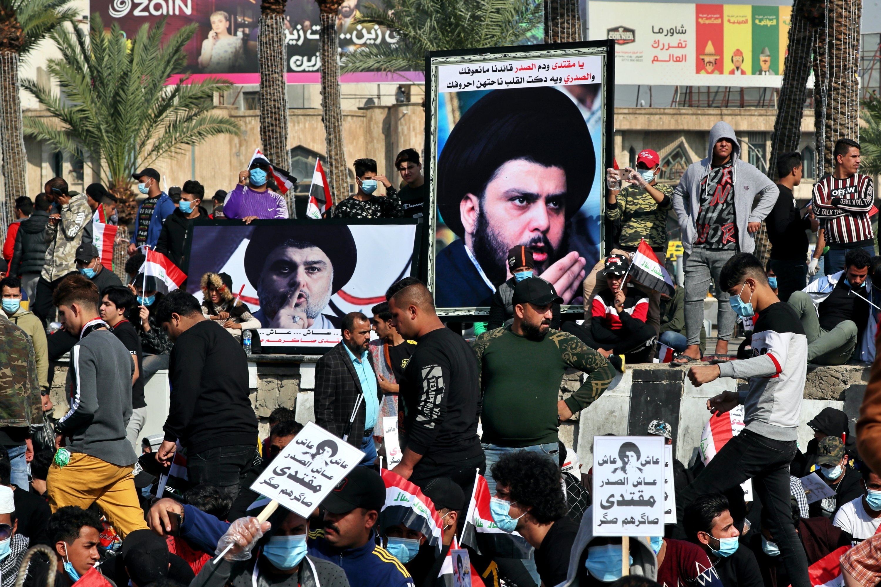 Followers of Shiite cleric Muqtada al-Sadr, in the posters, gather in Tahrir Square, Baghdad, Iraq, Friday, Nov. 27, 2020. (AP)