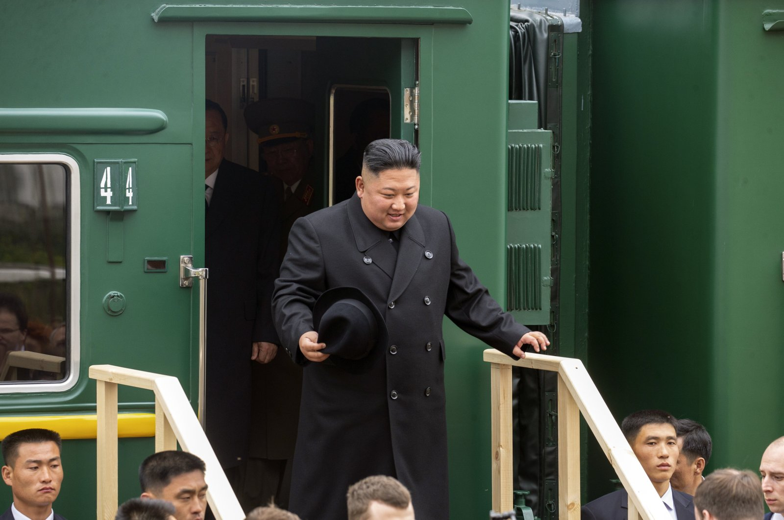 In this photo released by the press office of the administration of the Primorsky Krai region, North Korea's leader Kim Jong Un leaves a train carriage after arriving at the border station of Khasan, Primorsky Krai region, Russia, April 24, 2019. (AP Photo)