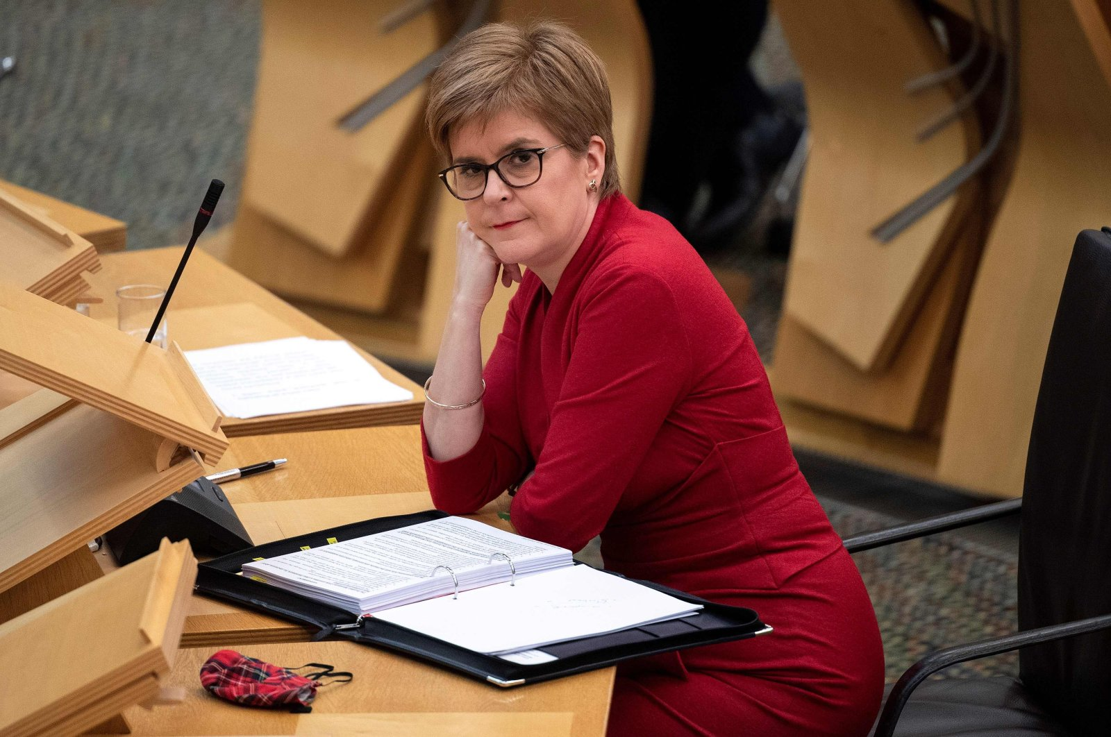 Scotland's First Minister Nicola Sturgeon reacts as she attends the First Minister's Questions session at the Scottish Parliament in Holyrood, Edinburgh, Nov. 26, 2020. (AFP Photo)