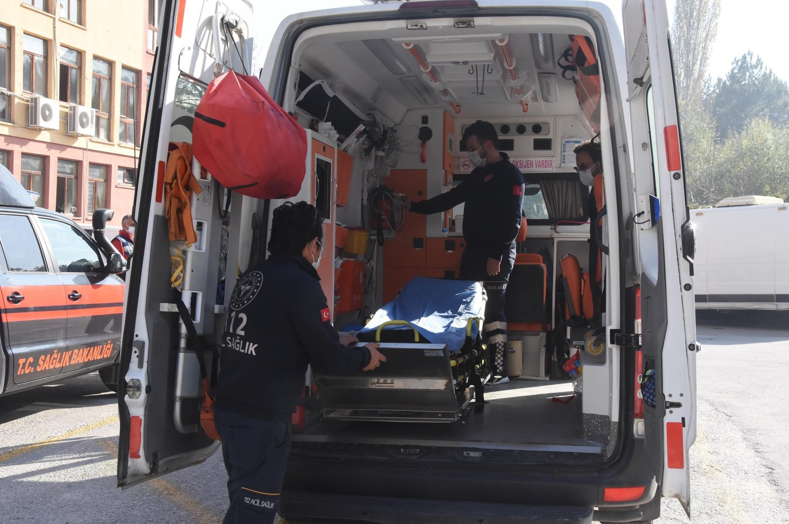 This file photo dated Nov. 14, 2020, shows the first responders who rushed to the aid of 4-year-old Ayda Gezgin after she was pulled from rubble in Izmir 91 hours after the devastating earthquake on Oct. 30, 2020, inside their ambulance in Kütahya, central Turkey. (DHA Photo)