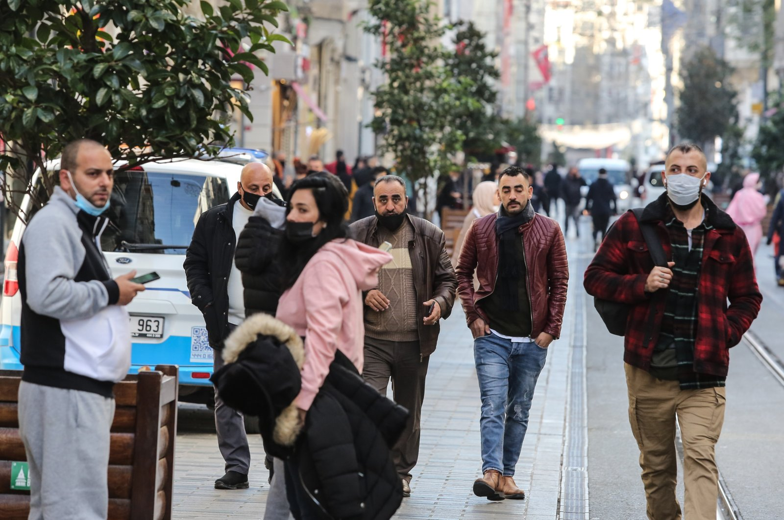 People, some wearing protective masks, walk on Istiklal Avenue, in Istanbul, Turkey, Nov. 27, 2020. (DHA Photo)