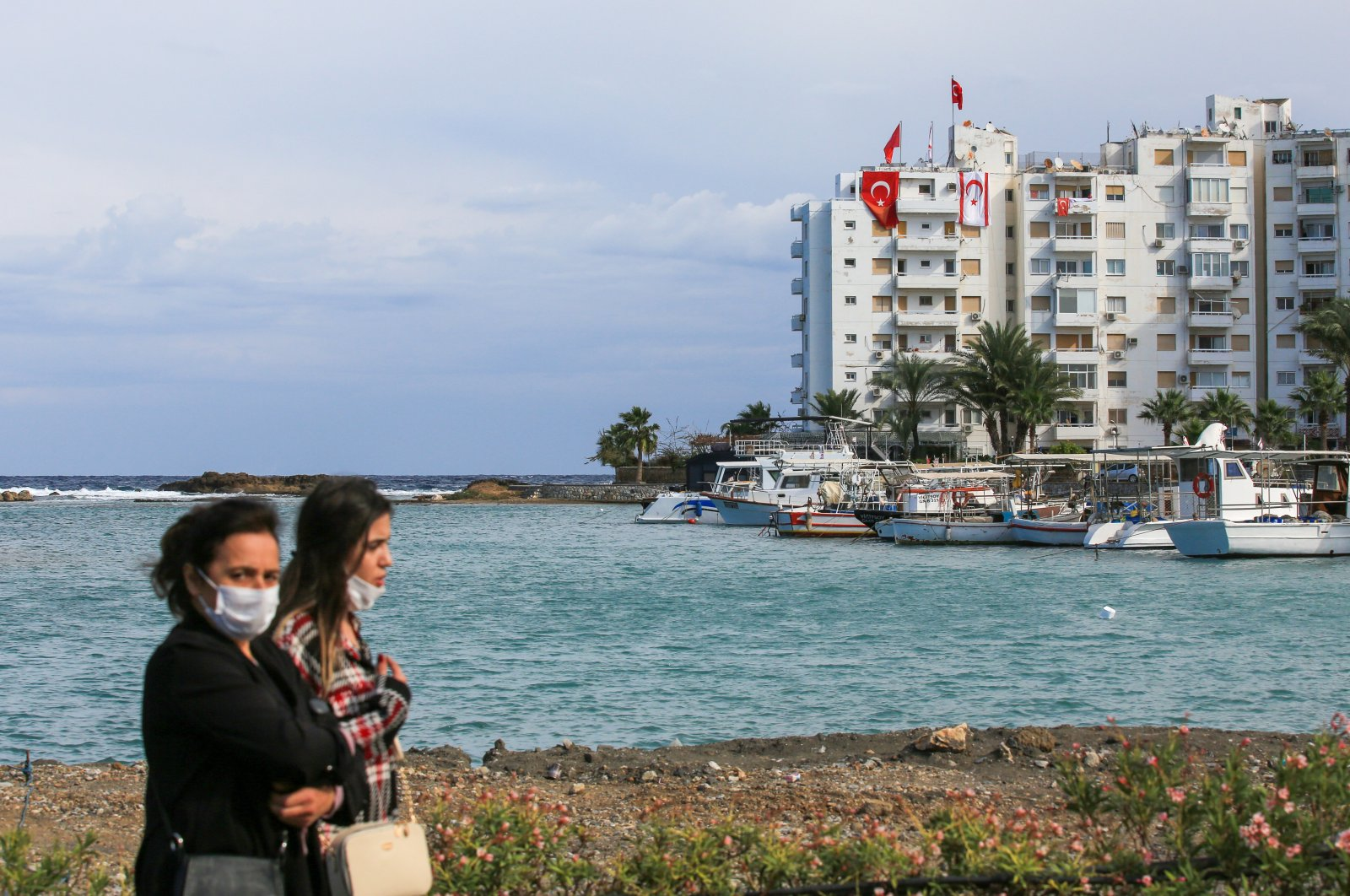 Women walk in the port city of Famagusta near the town of Maraş (Varosha), the Turkish Republic of Northern Cyprus (TRNC), Nov. 15, 2020. (Getty Images)