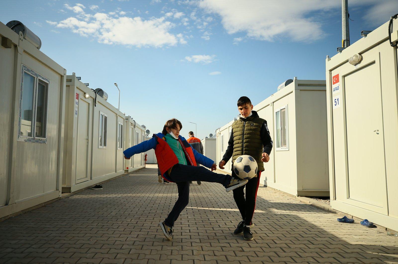 Children play football in an alley between housing units, in Izmir, western Turkey, Nov. 26, 2020. (AA Photo)