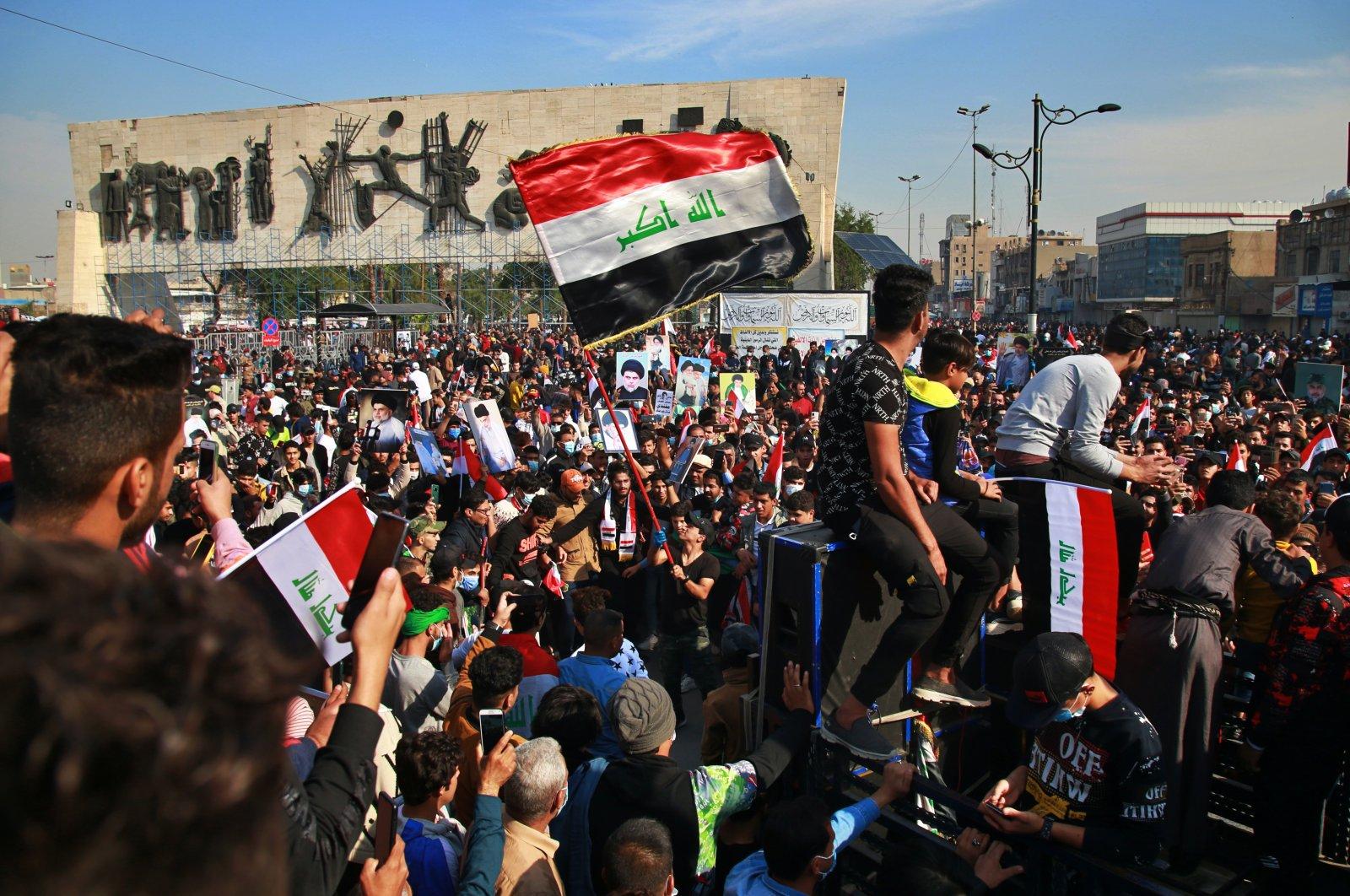 Followers of Shiite cleric Muqtada al-Sadr gather in Tahrir Square, Baghdad, Iraq, Nov. 27, 2020. (AP Photo)