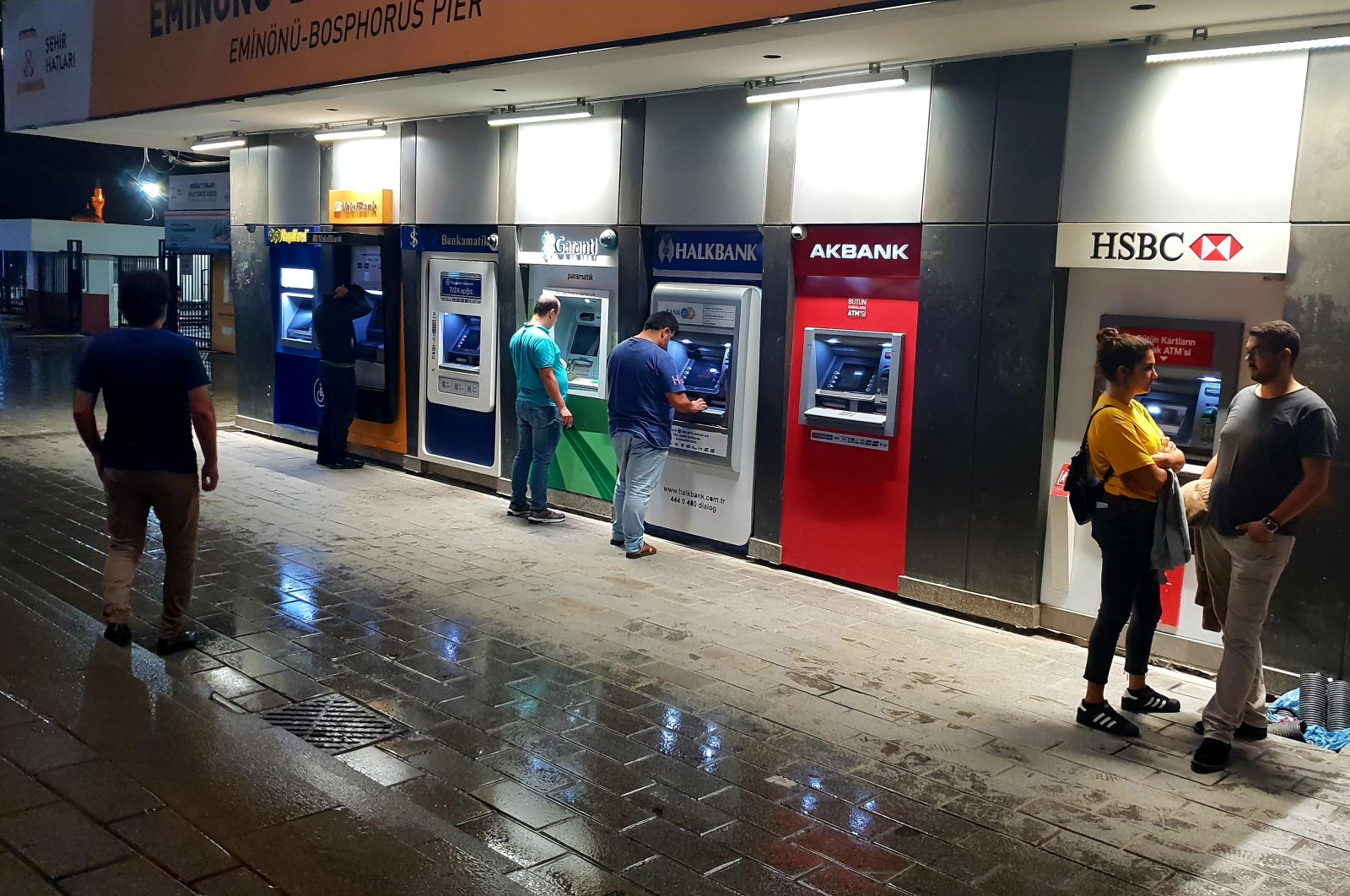 Customers use ATM machines in the Üsküdar district of Istanbul, Turkey, Sept. 14, 2018. (Shutterstock Photo)