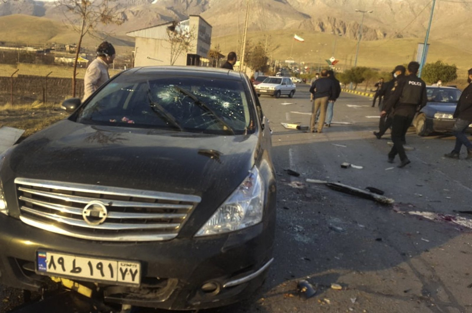 This photo released by the semi-official Fars News Agency shows the scene where Mohsen Fakhrizadeh was killed in Absard, a small city just east of the capital, Tehran, Iran, Friday, Nov. 27, 2020. (AP Photo)