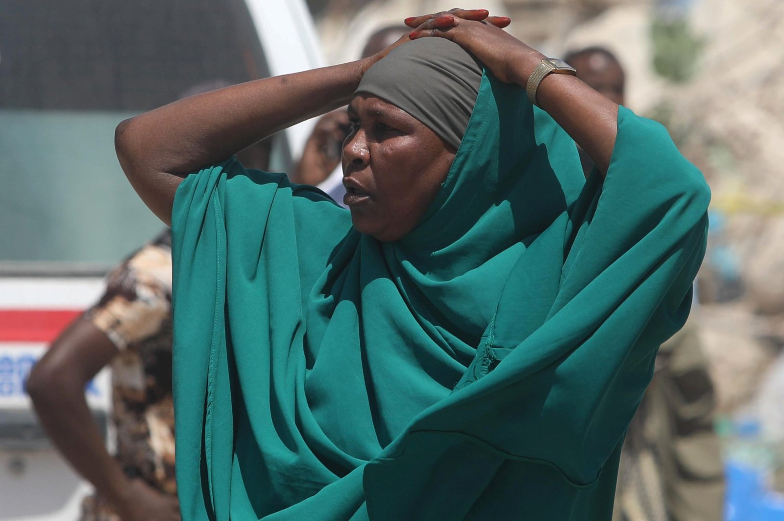 A woman reacts near the scene of a blast in the district office of Hawlwadag in Mogadishu, Somalia, Sept. 2, 2018. REUTERS