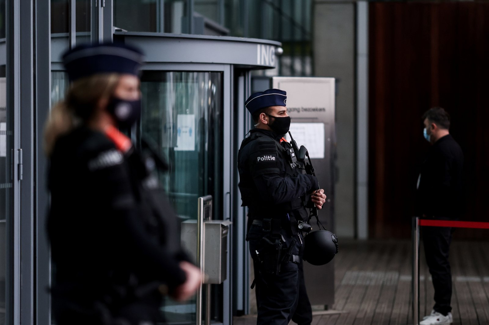 Belgian police officers stand guard at the entrance of an Antwerp courthouse, on Nov. 27, 2020, ahead of the start of the trial of four suspects including an Iranian diplomat accused of taking part in a plot to bomb an opposition rally. (AFP Photo)
