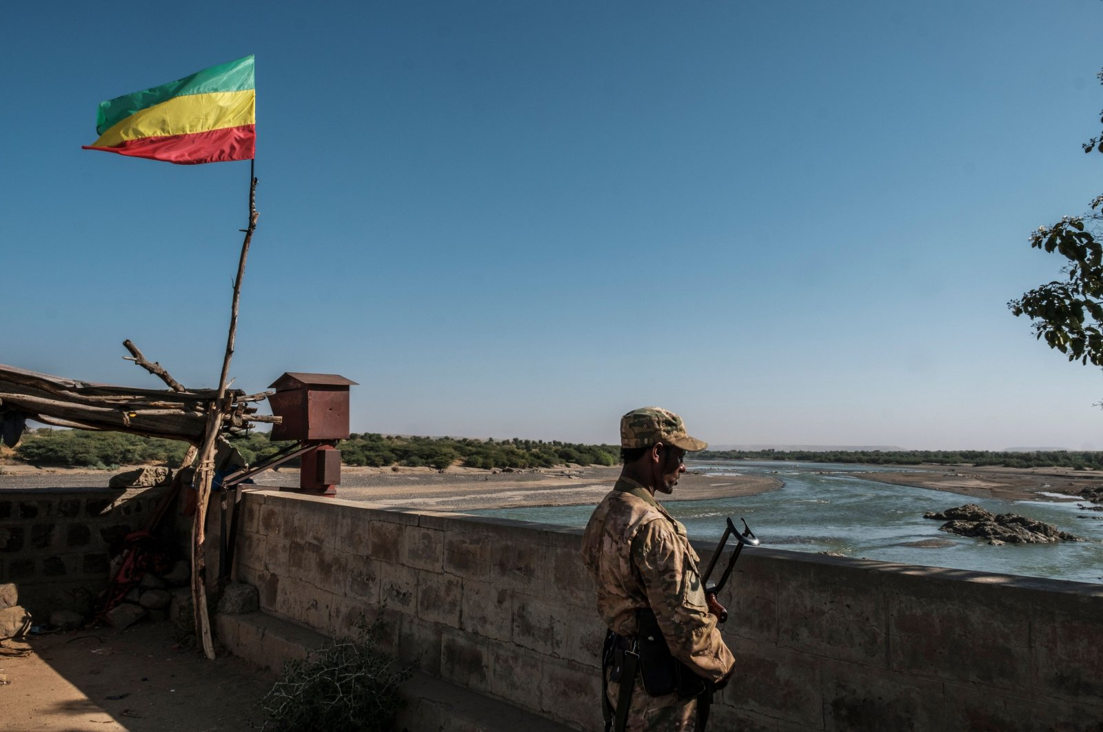 A member of the Amhara Special Forces watches on at the border crossing with Eritrea where an Imperial Ethiopian flag waves, in Humera, Ethiopia, on Nov. 22, 2020. (AFP)