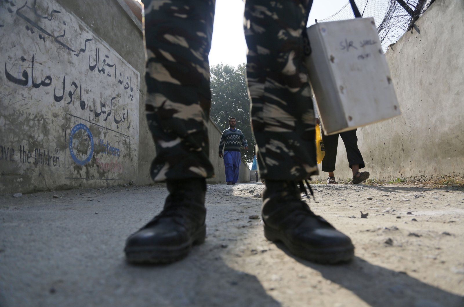 An Indian paramilitary soldier stands guard outside a polling station on the outskirts of Srinagar, Indian-controlled Kashmir, Oct. 24, 2019. (AP Photo)