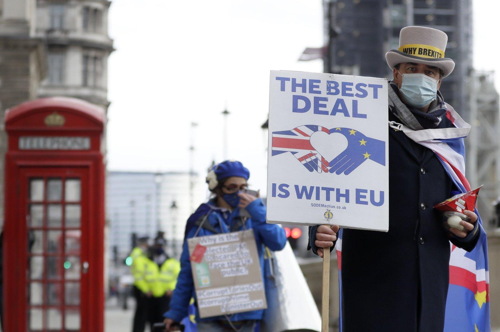 Steve Bray (R), a pro-EU campaigner, during a protest against a Brexit no-deal near Parliament in London, Nov. 25, 2020. (AP Photo)