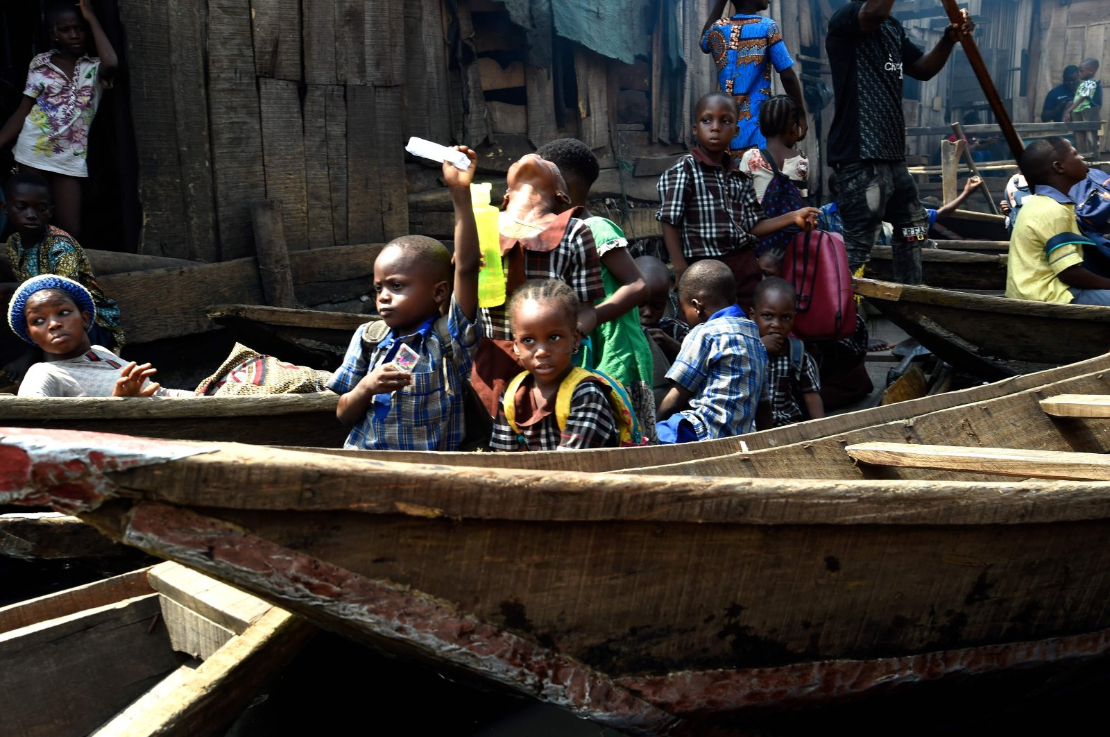 Pupils sit in canoe heading home in a makeshift home in the Makoko riverine slum settlement in Lagos, Nigeria, Nov. 27, 2020. (AFP photo)