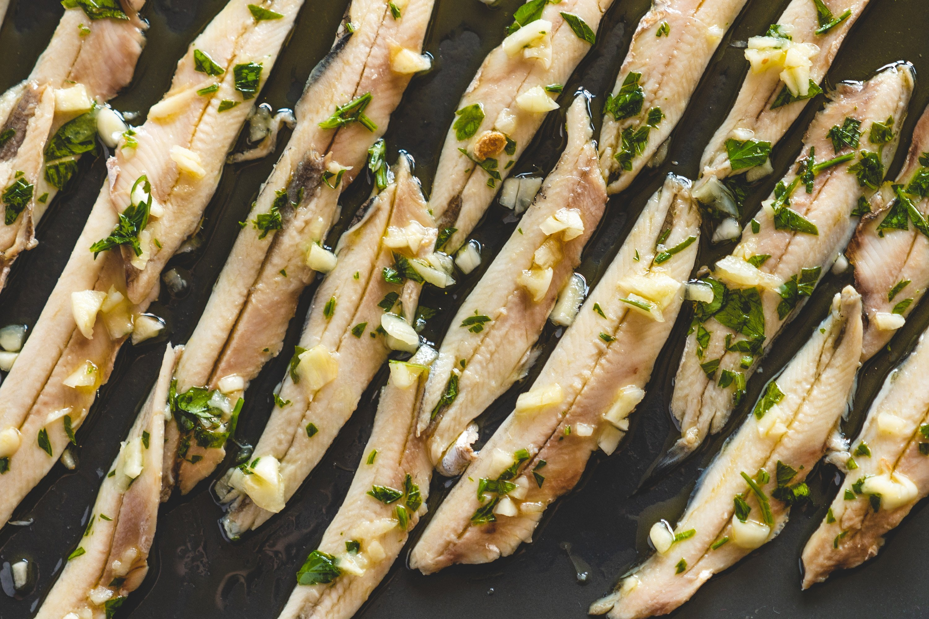 Pickled hamsi is best served with lemon, garlic and parsley. (Shutterstock Photo)