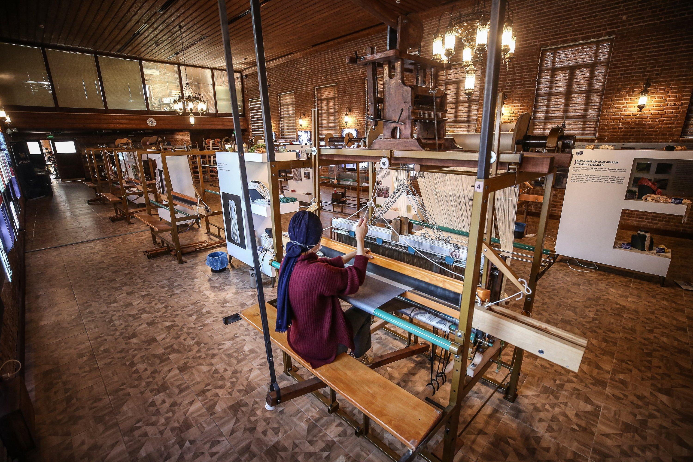 A weaver weaves fabrics on the dobby jacquard loom at the Umurbey Silk Production and Design Center in Bursa, northwestern Turkey, Nov. 27, 2020. (AA PHOTO)
