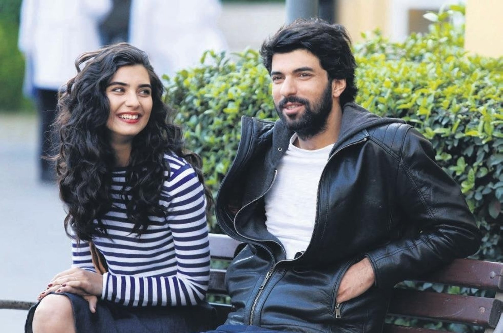 "Actress Tuba Büyüküstün (L) and actor Engin Akyürek in a scene from ""Kara Para Aşk."""