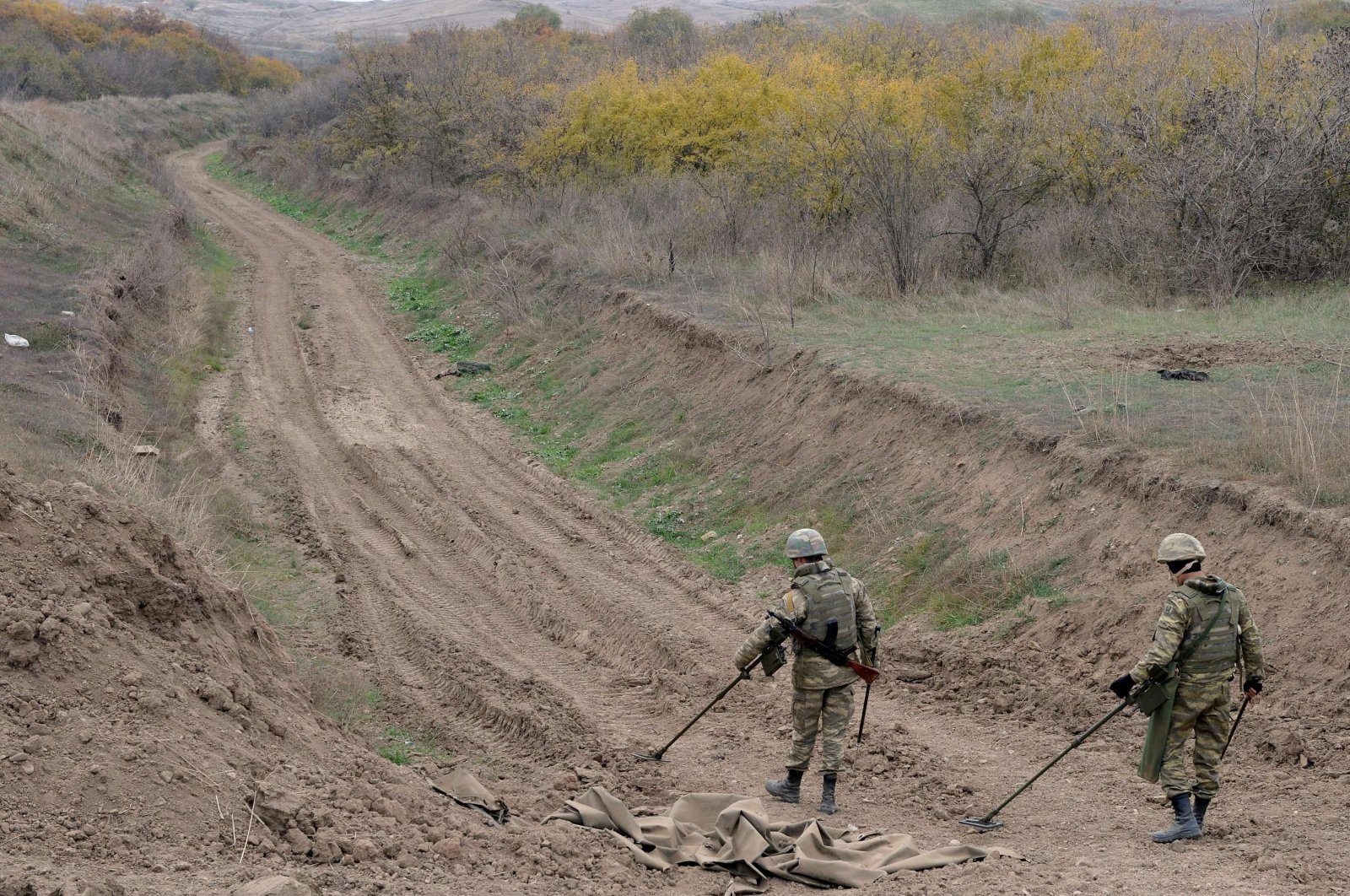 Azerbaijan military sappers clear mines in the countryside outside the town of Fuzuli, Azerbaijan, Nov. 26, 2020. (AFP Photo)