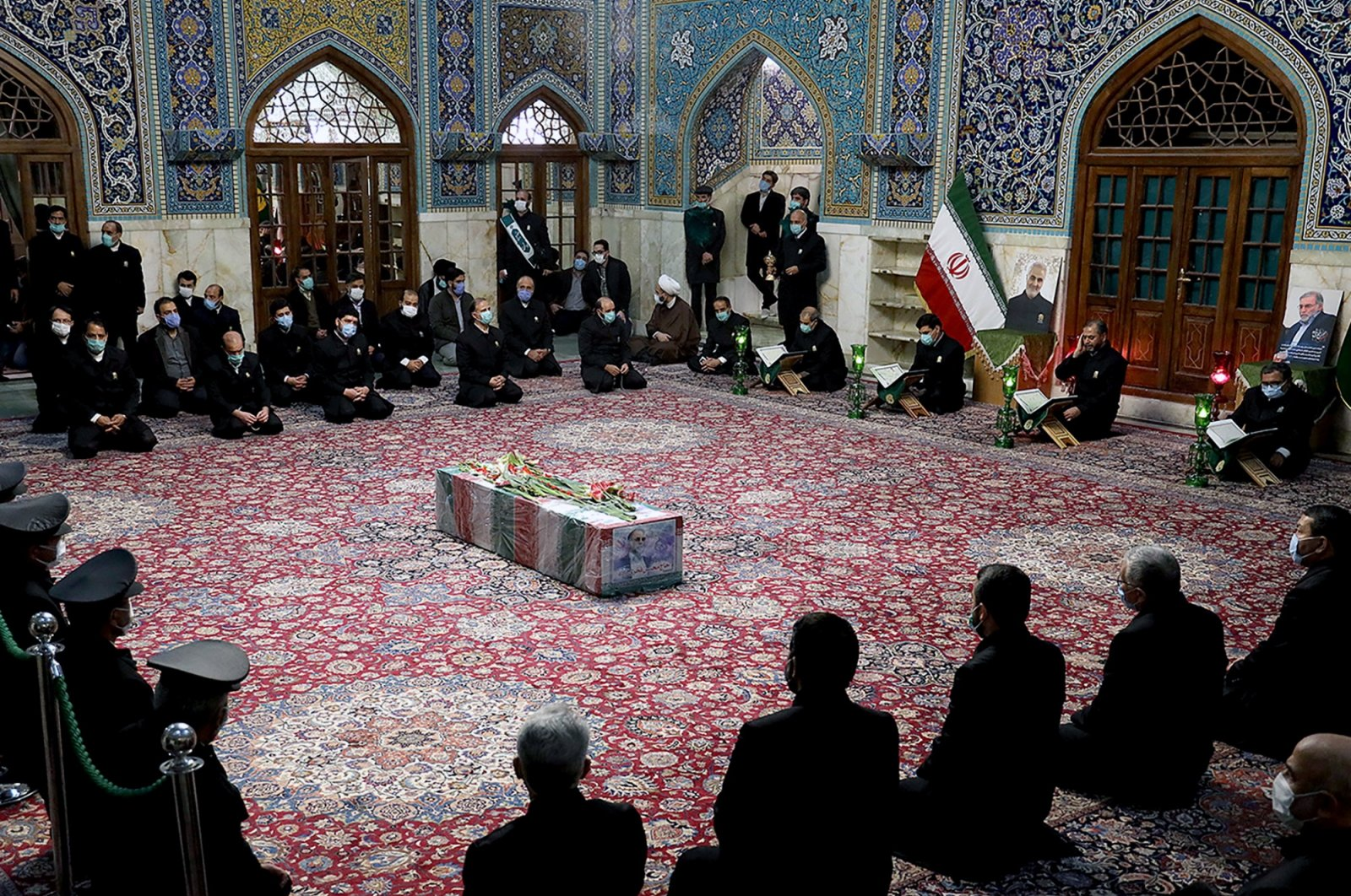 A coffin with an image of assassinated Iranian nuclear scientist Mohsen Fakhrizadeh can be seen among the servants of the holy shrine of Imam Reza in Mashhad, Iran, Nov. 29, 2020. (Reuters Photo)