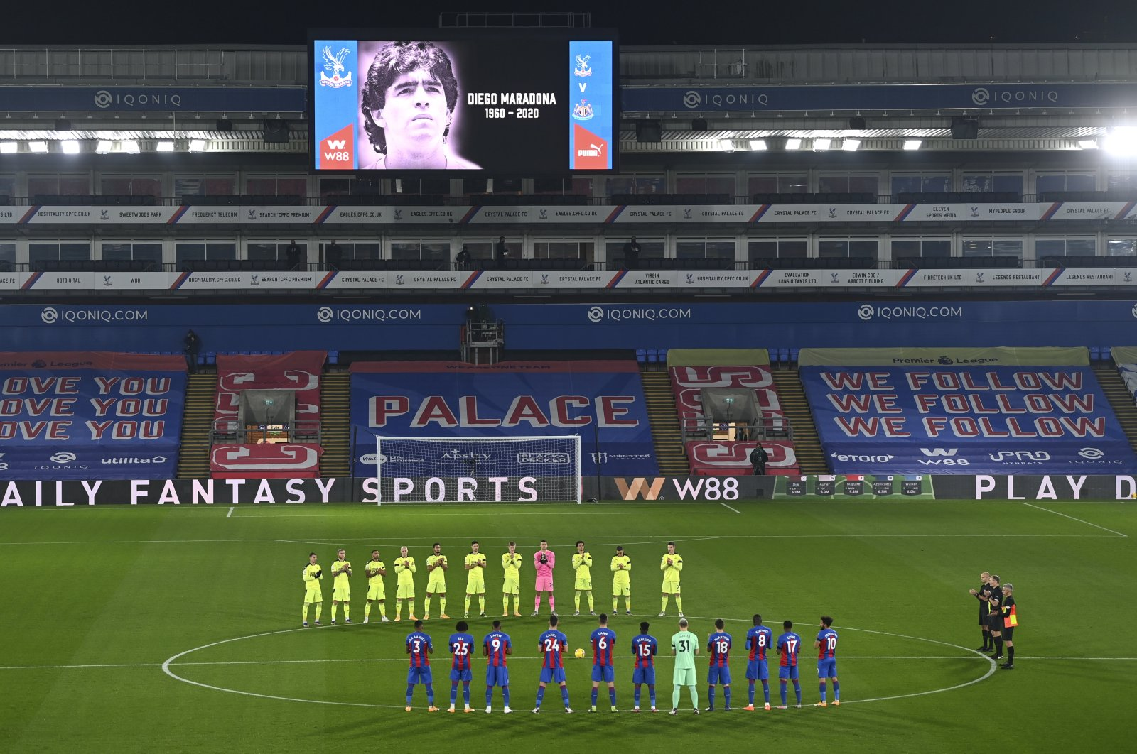 Players applaud as a mark of respect for Diego Maradona ahead of the Premier League match between Crystal Palace and Newcastle United, in London, Britain, Nov. 27, 2020. (AP Photo)