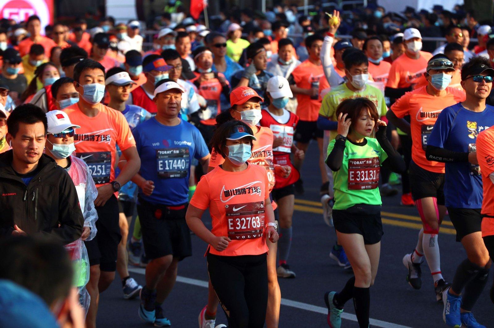 Runners take part in the Shanghai International Marathon in Shanghai, China, Nov. 29, 2020. (AFP Photo)