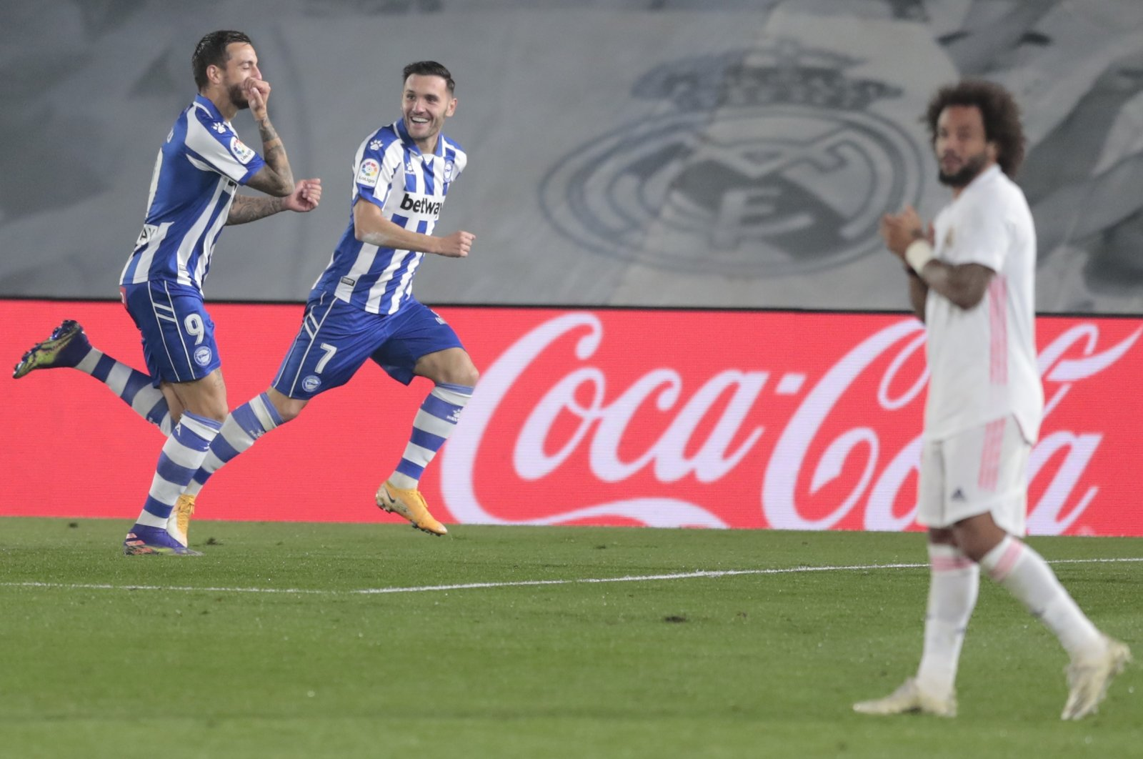 Real Madrid's Marcelo (R) looks dejected as Alaves players celebrate a goal during a La Liga match in Madrid, Spain, Nov. 28, 2020. (AP Photo)