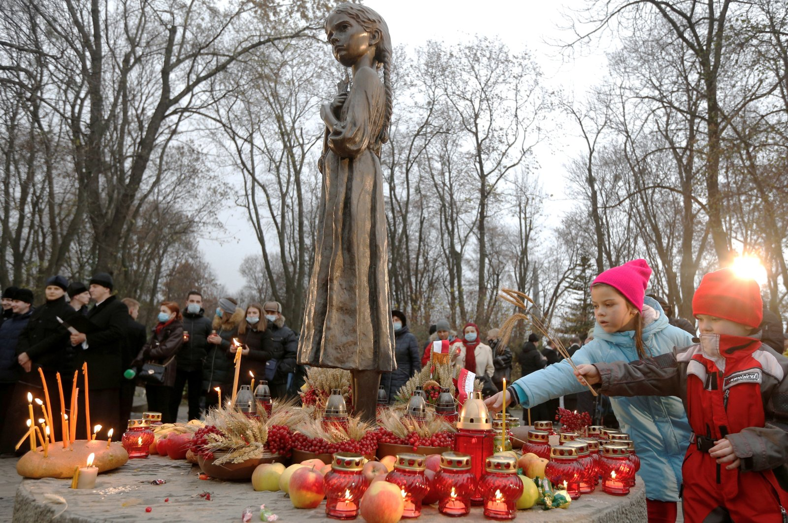 People visit a monument to Holodomor victims during a commemoration ceremony marking the 87th anniversary of the famine of 1932 and 1933, Kyiv, Ukraine, Nov. 28, 2020. (Reuters Photo)