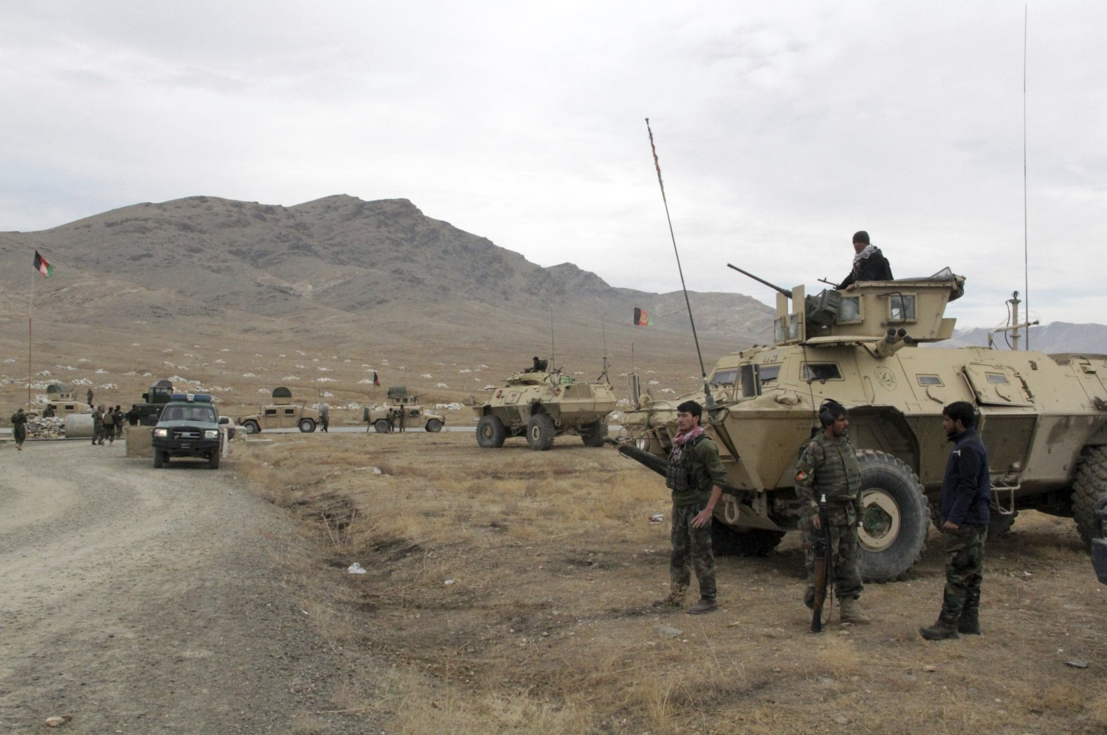 Afghan national army soldiers arrive at the site of a suicide bombing in Ghazni province west of Kabul, Afghanistan, Sunday, Nov. 29, 2020. (AP Photo)