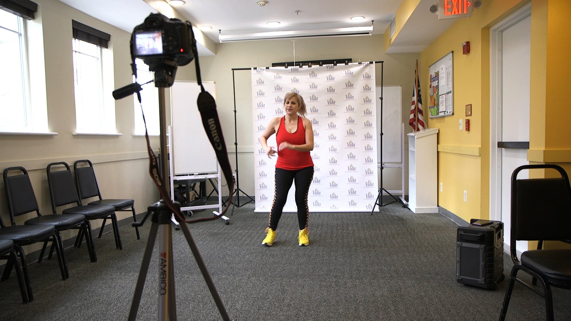 A dance instructor records a Zumba and exercise lesson that will be uploaded to the social media accounts of Vida Senior Center, in Washington, D.C., U.S., March 17, 2020. (AP Photo)