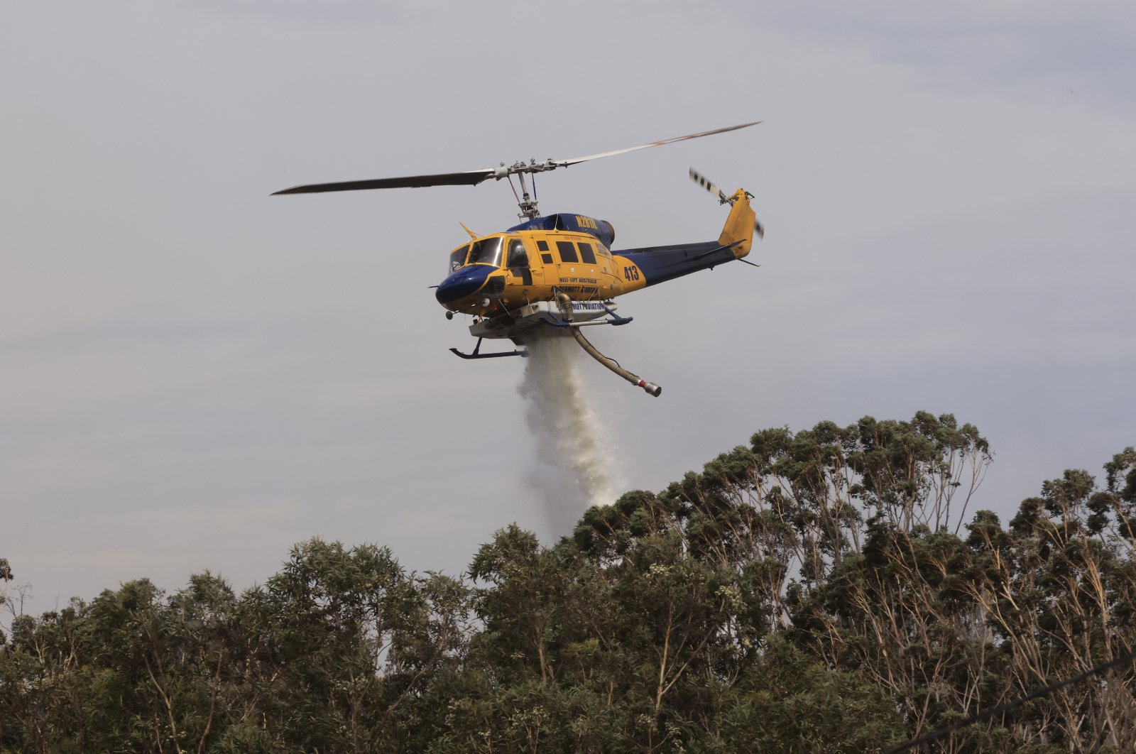 Helicopters are seen water bombing an out-of-control bushfire at Northmead in Sydney, Australia, Nov. 29, 2020. (Getty Images)