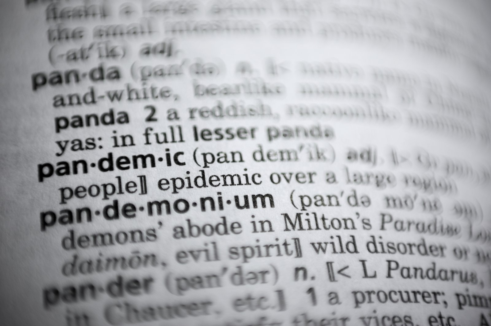 A photo of the word pandemic is displayed in a dictionary in Washington, D.C., U.S., Nov. 21, 2020. (AP Photo)