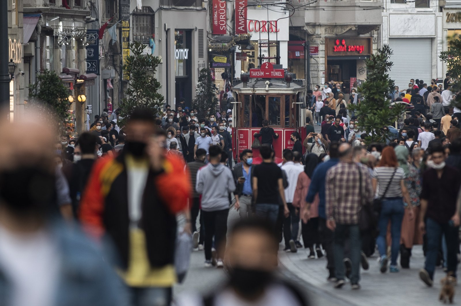 People wearing protective masks walk on Istiklal Street amid the ongoing coronavirus pandemic in Istanbul, Turkey, Oct. 25, 2020. (EPA Photo)