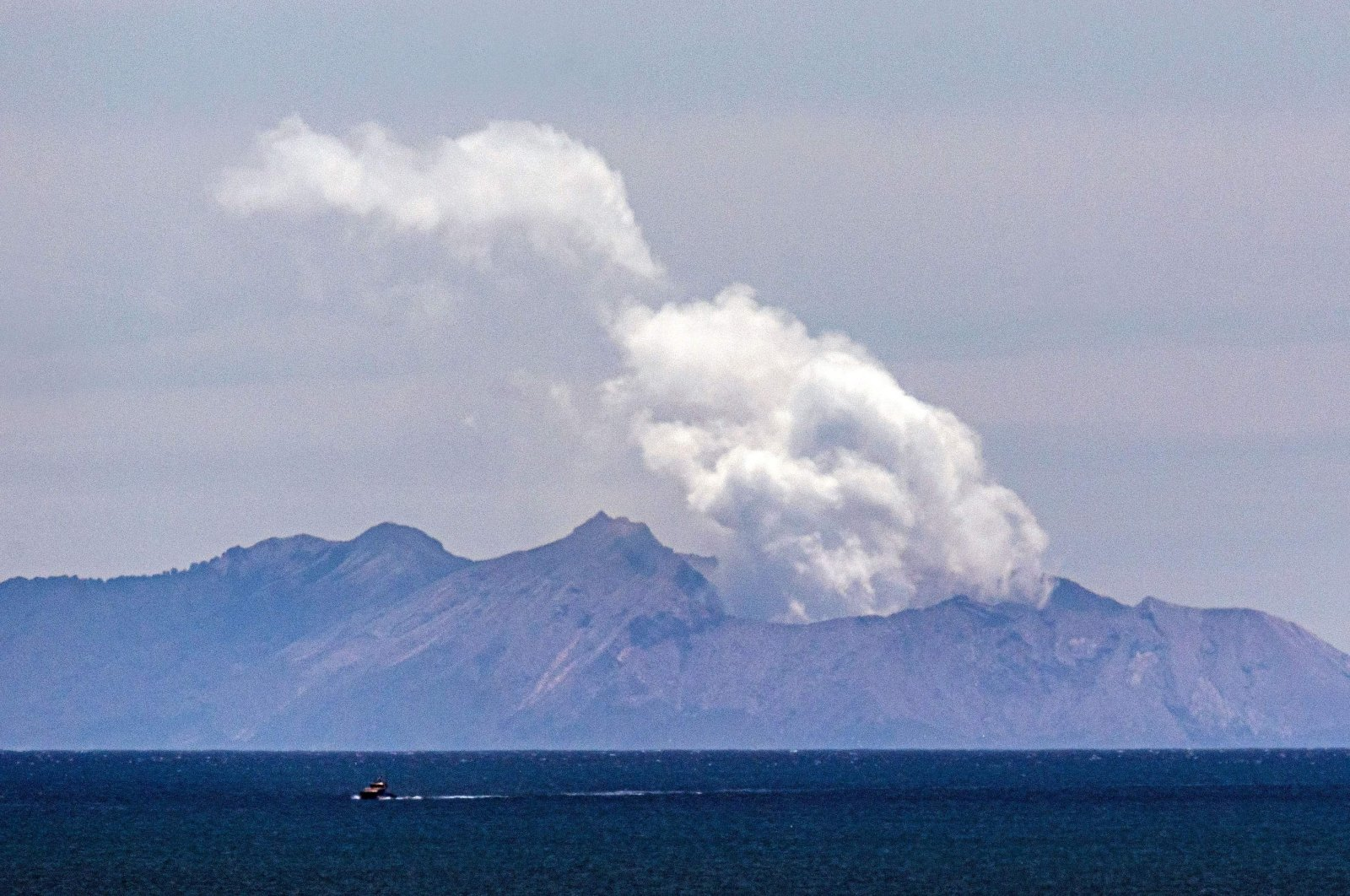 In this file photo, steam rises from the White Island volcano following a volcanic eruption on Dec. 9, 2019, in Whakatane, Dec. 11, 2019. (AFP Photo)