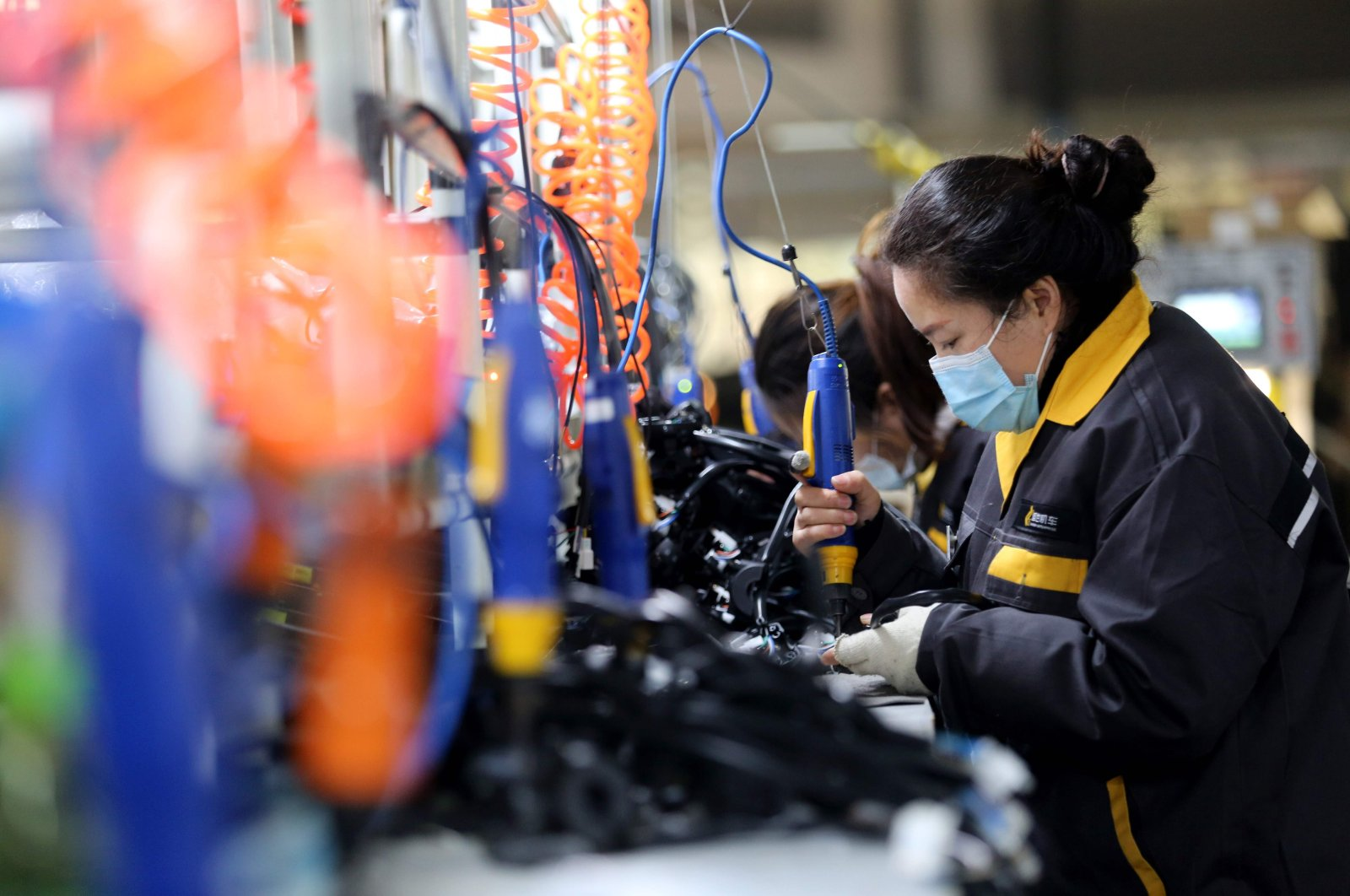 A worker in a motorcycle parts factory in Huaibei, in China's eastern Anhui Province, Nov. 28, 2020. (AFP Photo)