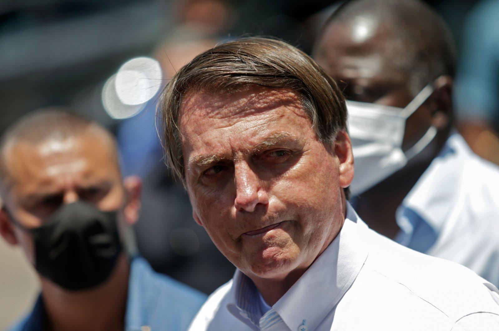 Brazilian President Jair Bolsonaro gestures as he speaks to the press after voting during the second round of municipal elections at the Rosa da Fonseca Municipal School, in the Military Village, Rio de Janeiro, Brazil, Nov. 29, 2020. (AFP Photo)