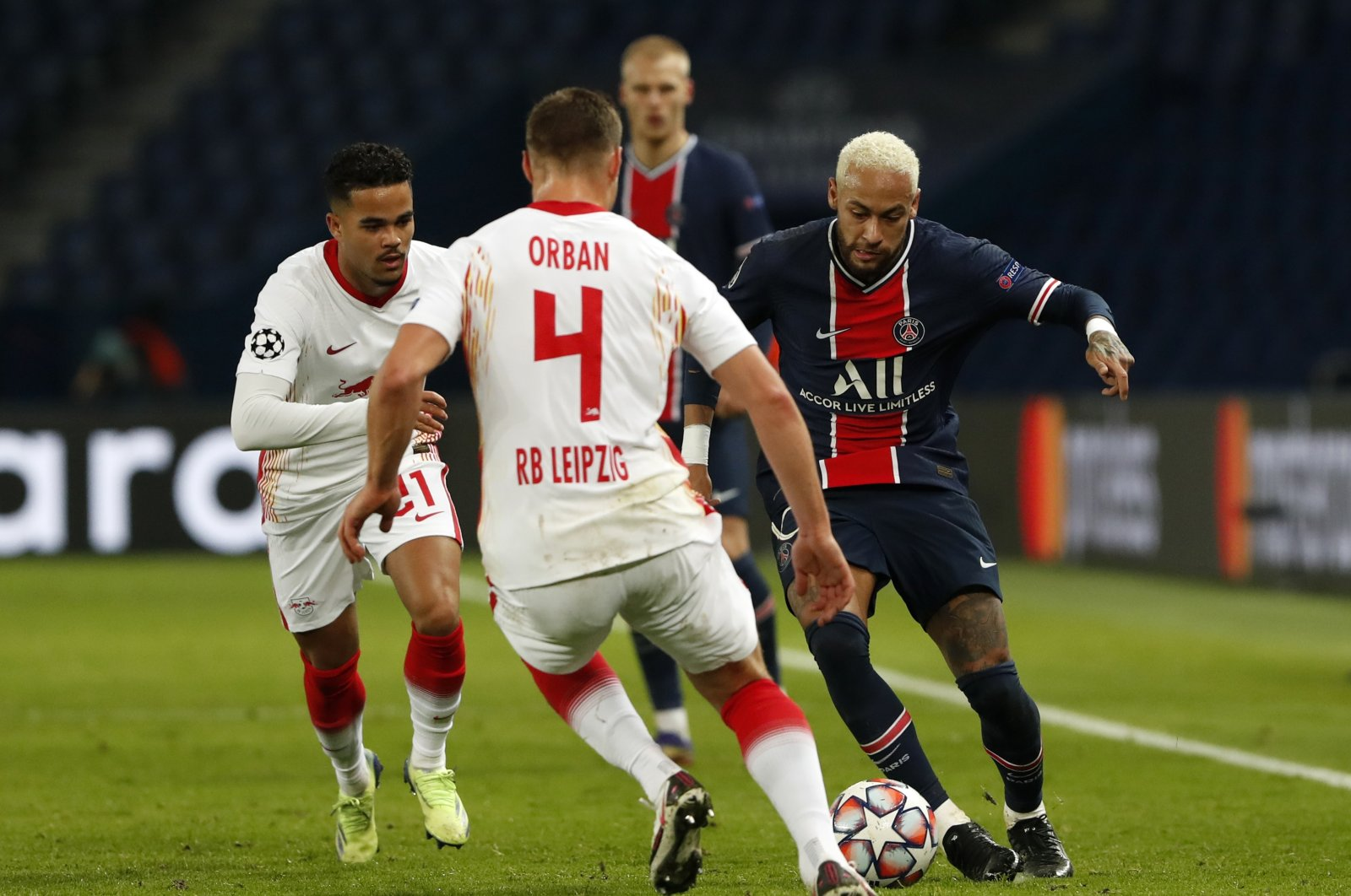 PSG's Neymar (R) duels for the ball with Leipzig's Willi Orban (C) and Justin Kluivert, during a Champions League match in Paris, France, Nov. 24, 2020. (AP Photo)