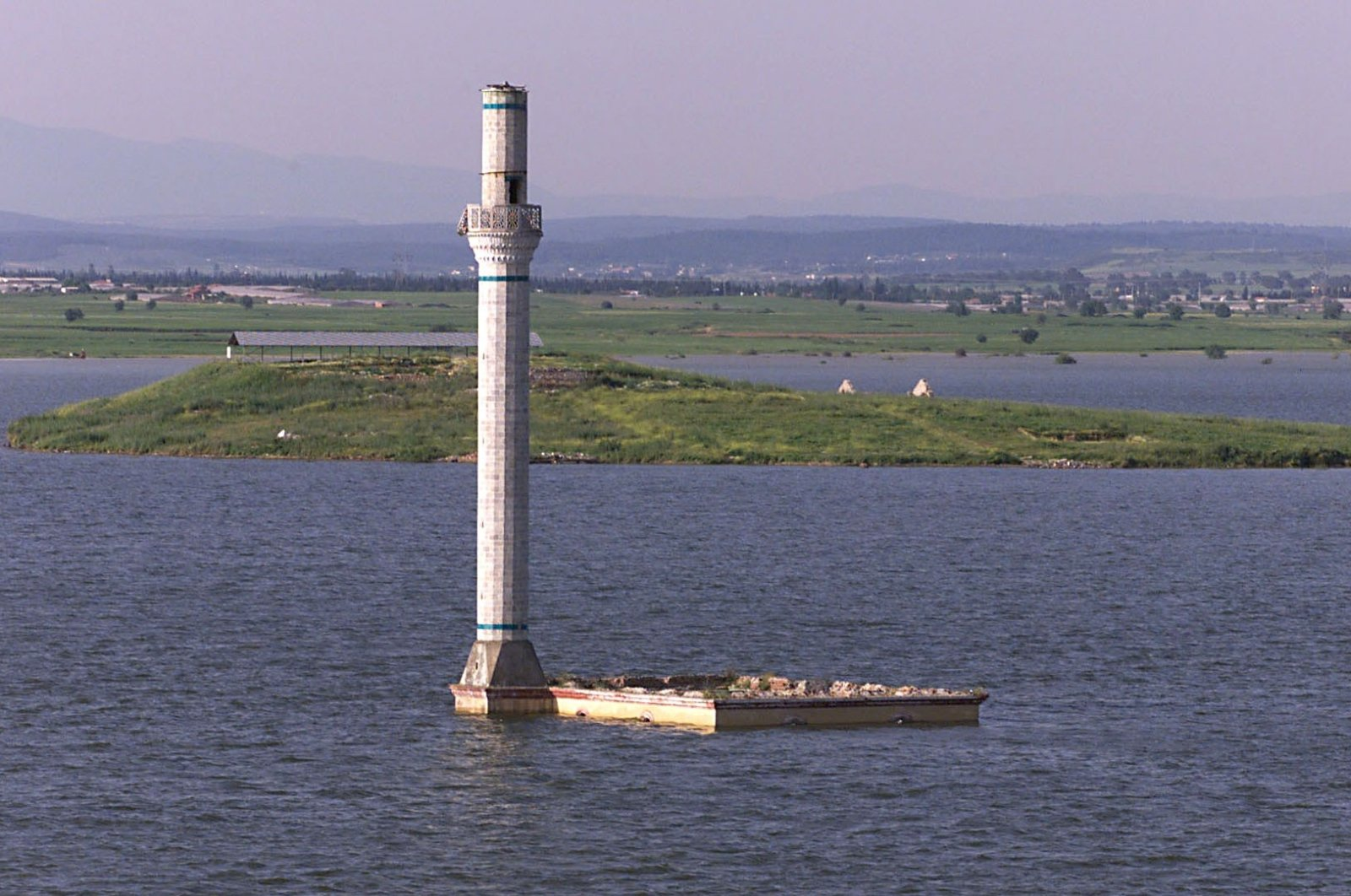 The minaret of an old mosque submerged under the Tahtalı Dam reservoir emerges after water levels receded, in Izmir, Turkey, Nov. 26, 2020. (IHA Photo)