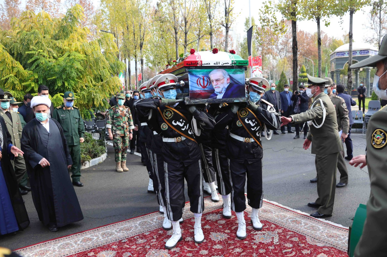 A handout photo made available by the Iranian defense ministry office shows soldiers carrying the coffin of slain Iranian nuclear scientist Mohsen Fakhrizadeh during a funeral procession inside the Iranian defense ministry in Tehran, Iran, Nov. 30, 2020. (EPA Photo)