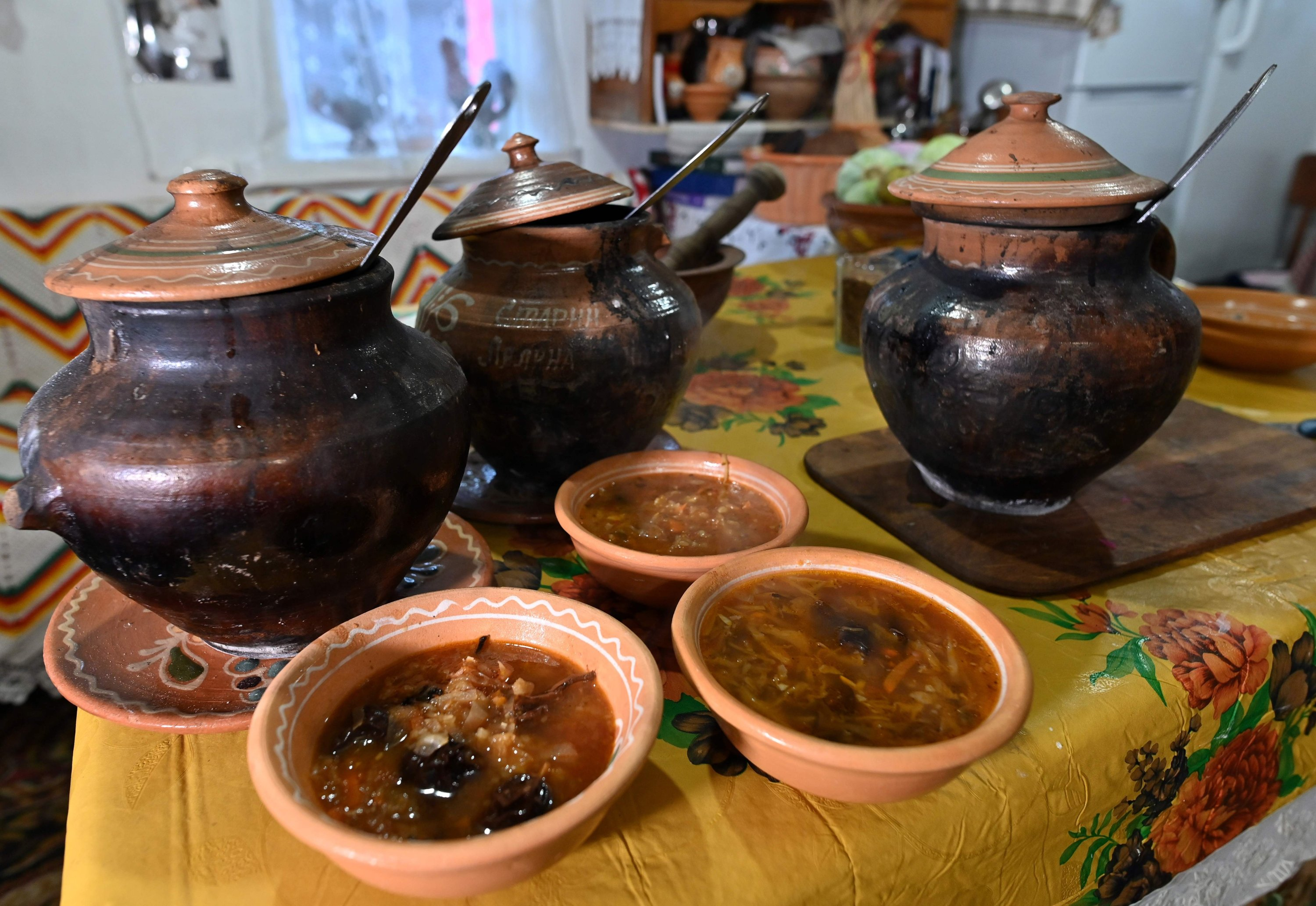 This picture shows three different borscht, cooked according to traditional recipes in the wood stove in the village of Opishnya in Poltava region, Nov. 26, 2020. (AFP Photo)
