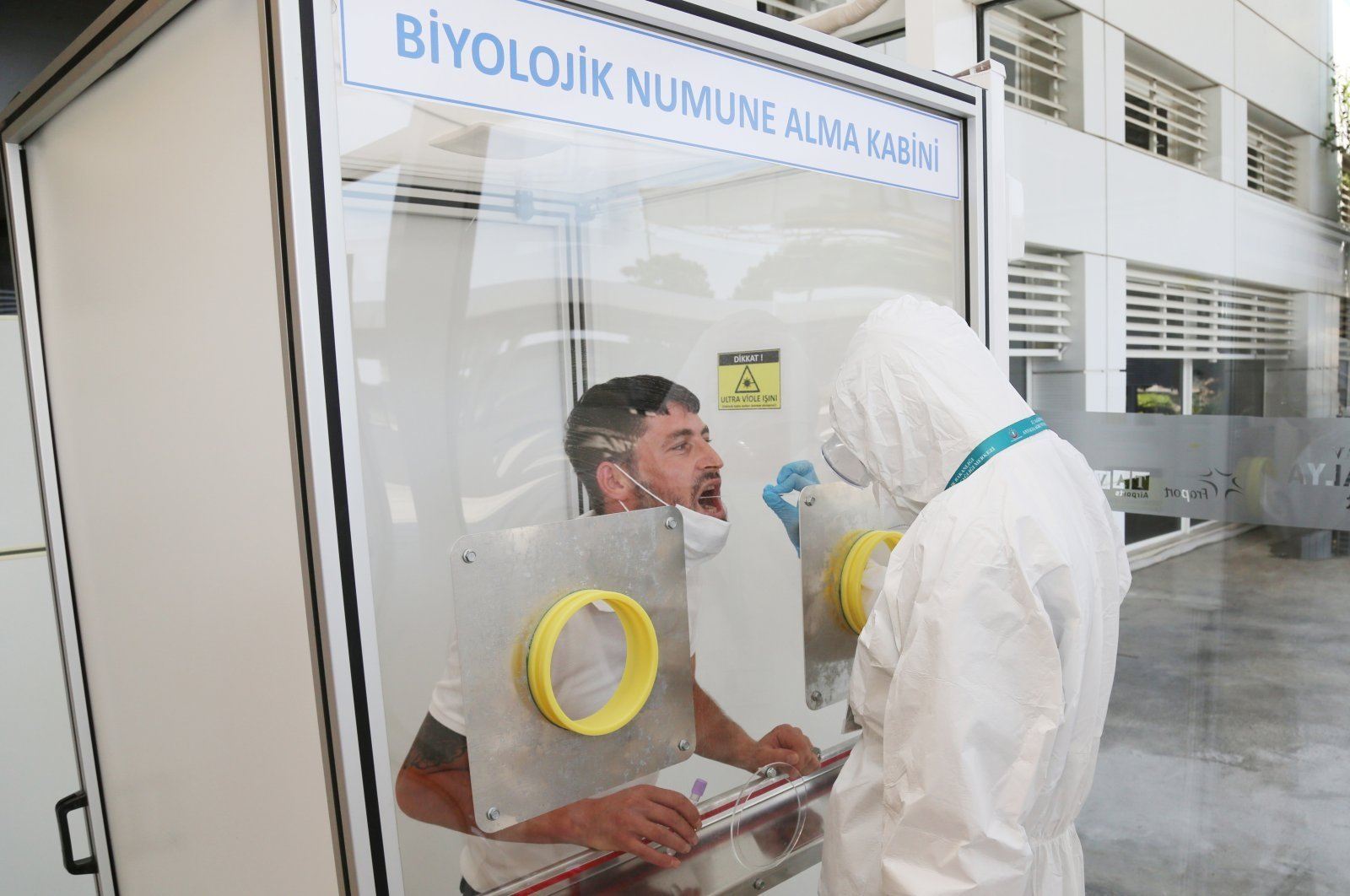 A man is tested for COVID-19 at an airport in Antalya, southern Turkey, Aug. 30, 2020. (DHA Photo)