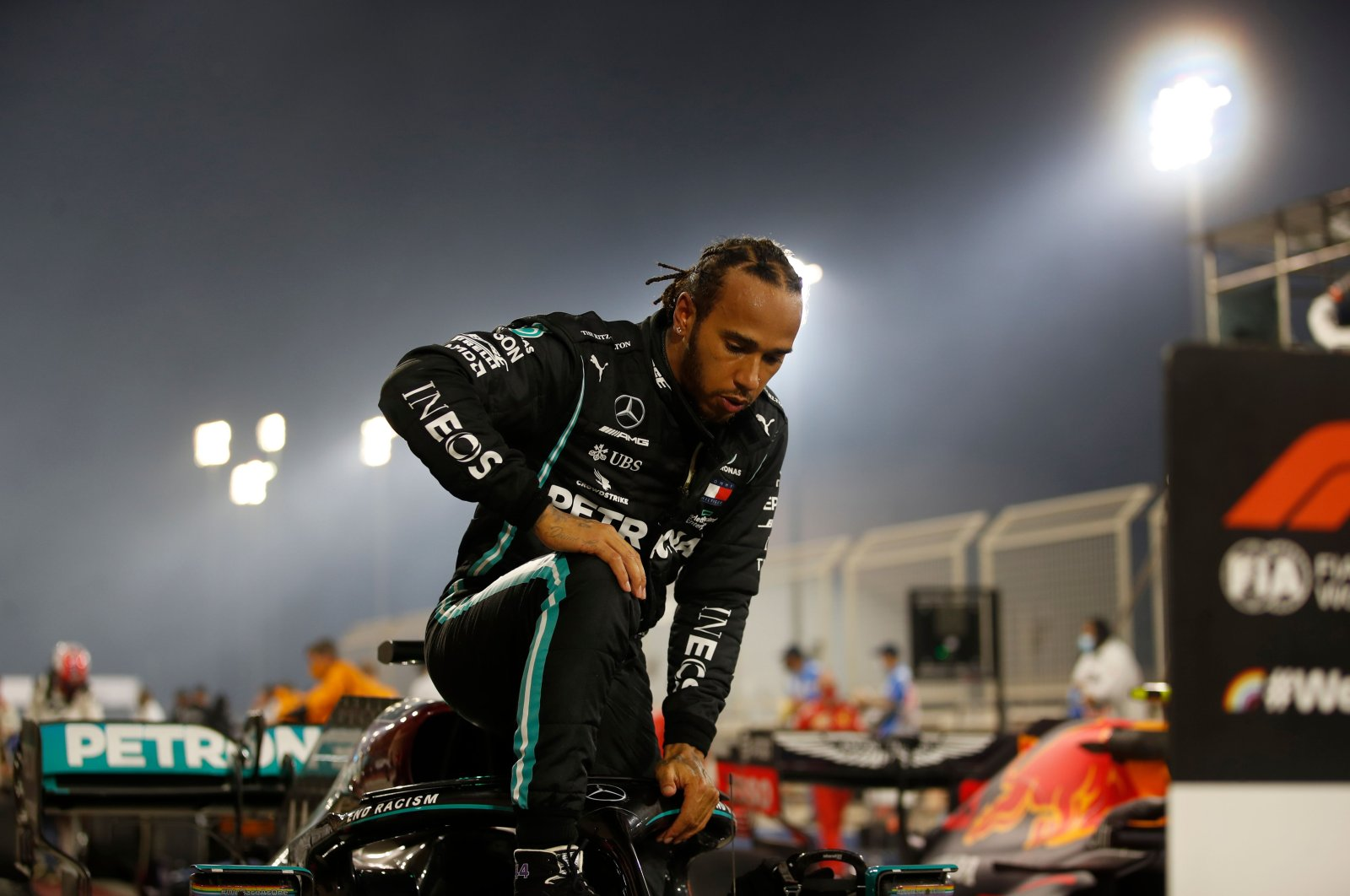 Lewis Hamilton steps out of his car after winning the Bahrain Formula One Grand Prix, Sakhir, Bahrain, Nov. 29, 2020. (AFP Photo)