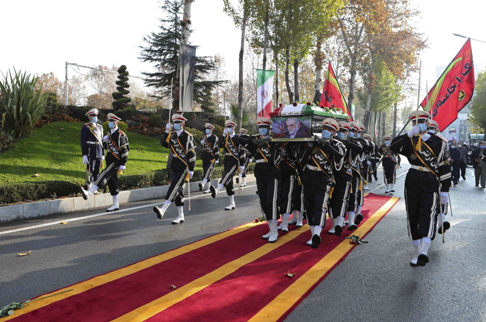 Iranian military personnel carry the flag-draped coffin of assassinated nuclear scientist Mohsen Fakhrizadeh, in a funeral ceremony, Tehran, Iran, Nov. 30, 2020. (AP Photo)