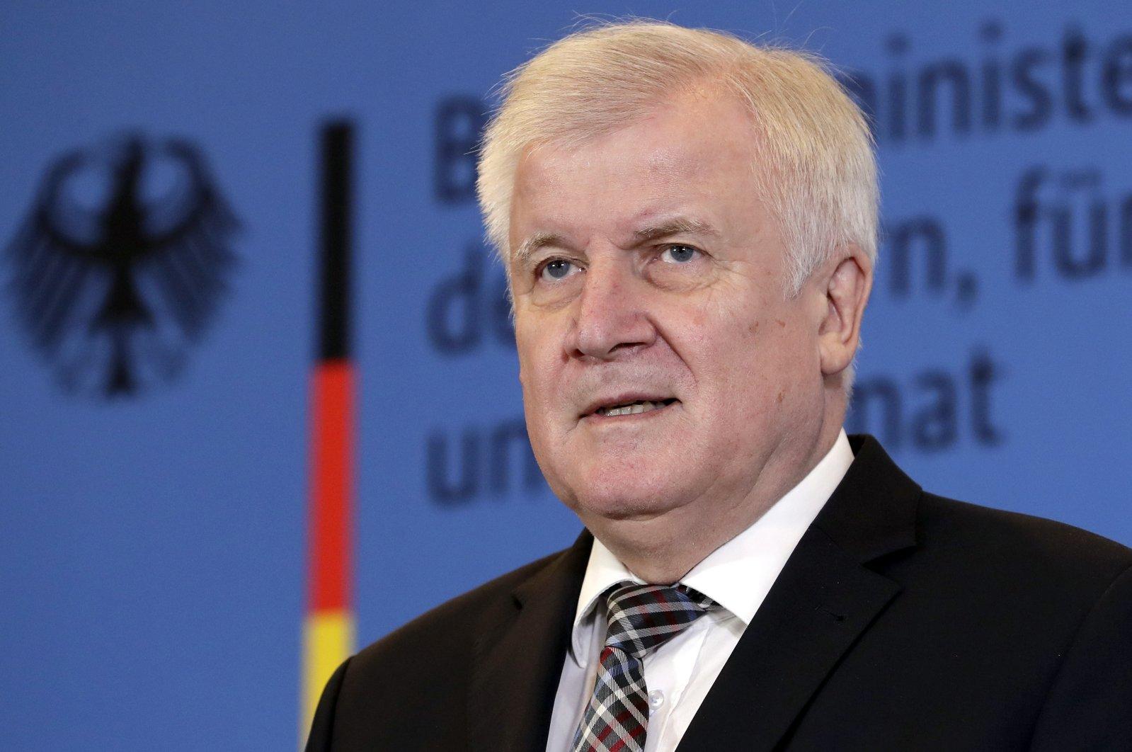 German Interior Minister Horst Seehofer addresses the media during a press conference, Berlin, Nov. 5, 2018. (AP Photo)