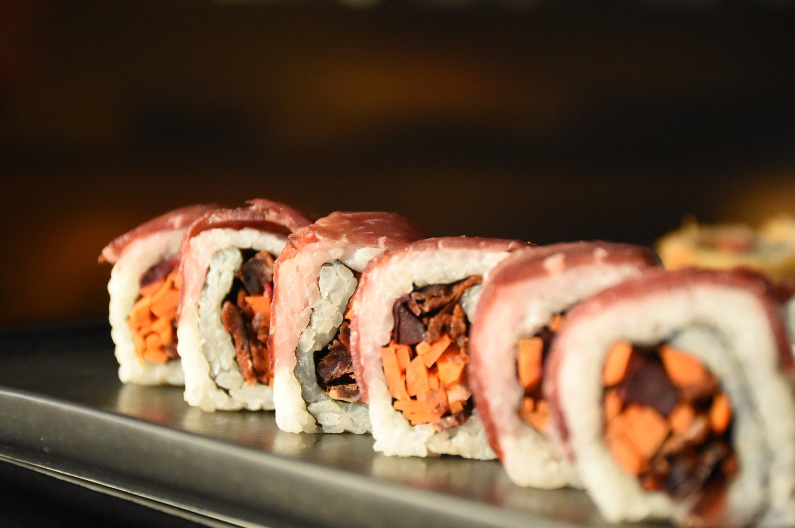 "The sushi is wrapped in a layer of pastırma and contains ""rami"" sauce, çemen and pastırma bits. (AA Photo)"