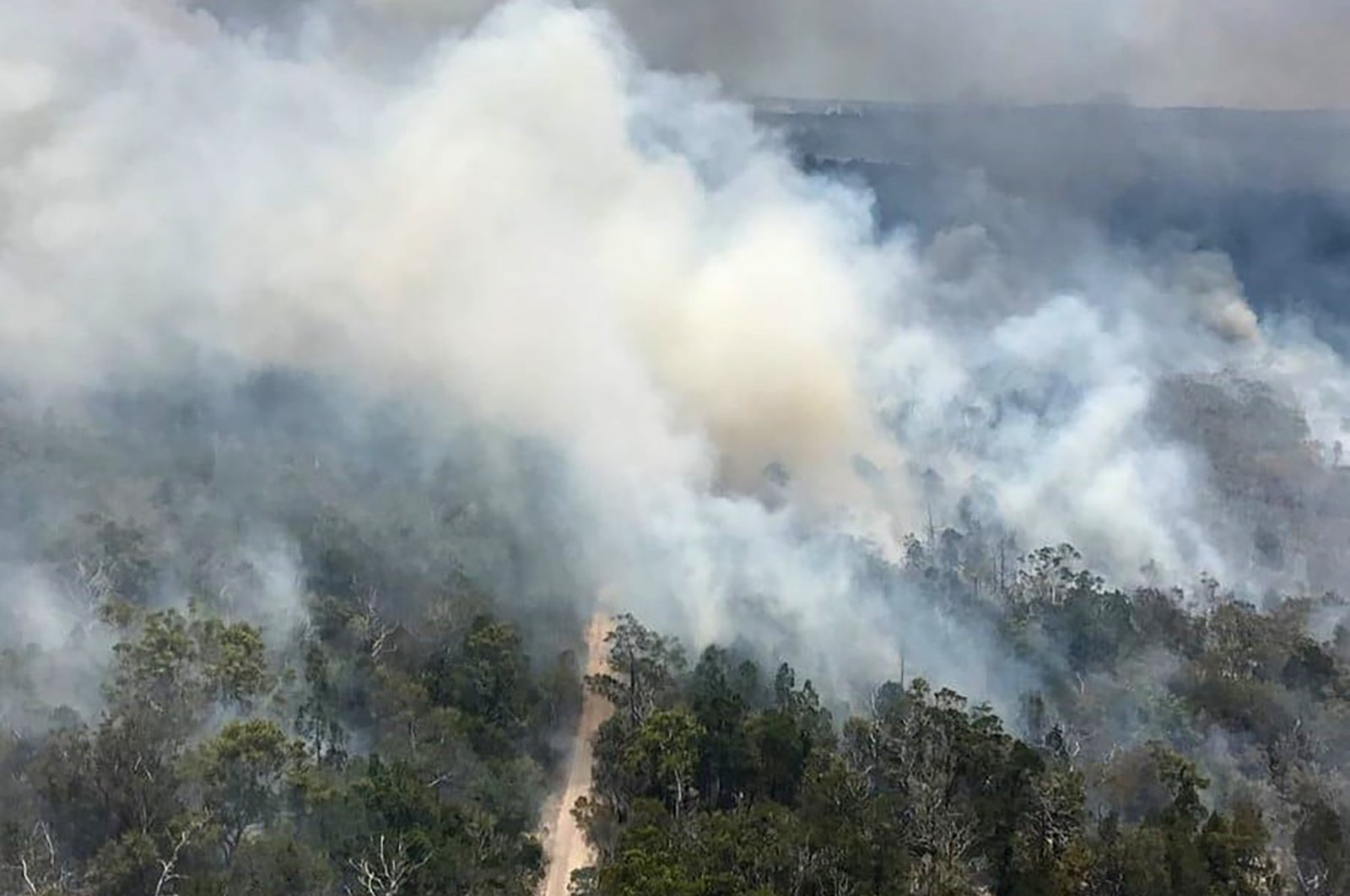 This handout picture taken on Nov. 29, 2020, and released by the Queensland Fire and Emergency Services shows an aerial view of bush fires on Fraser Island, off Australia's east coast. (AFP Photo)