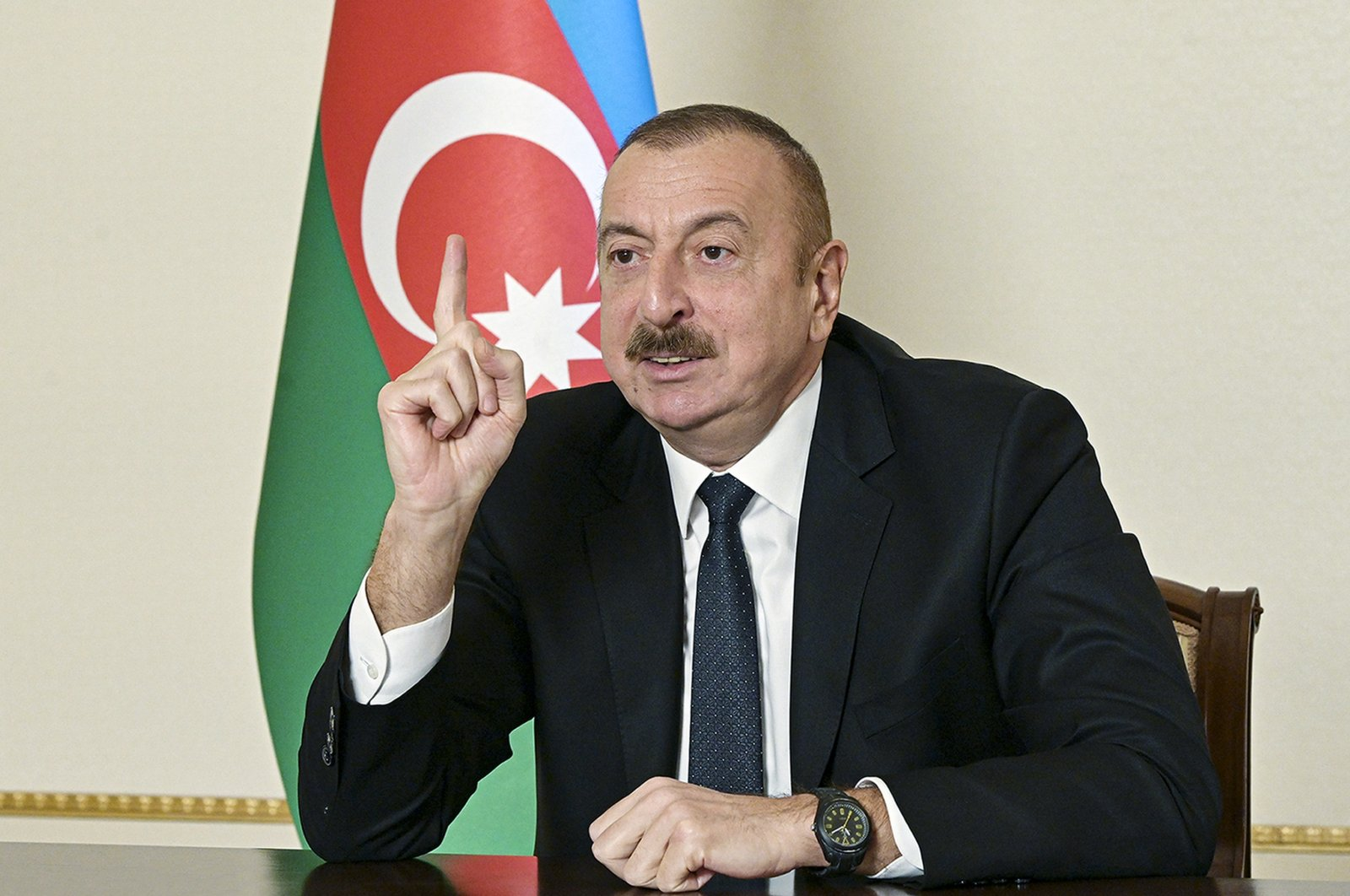Azerbaijani President Ilham Aliyev gestures as he addresses the nation in Baku, Azerbaijan on Wednesday, Nov. 25, 2020. (Azerbaijani Presidential Press Office via AP)
